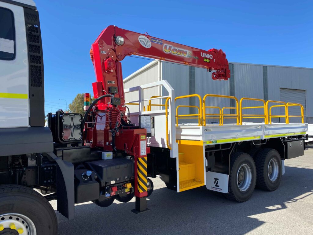 Heavy-duty truck-mounted HIAB crane fitted to a flat tray truck in Perth for service in the Western Australian mining industry.