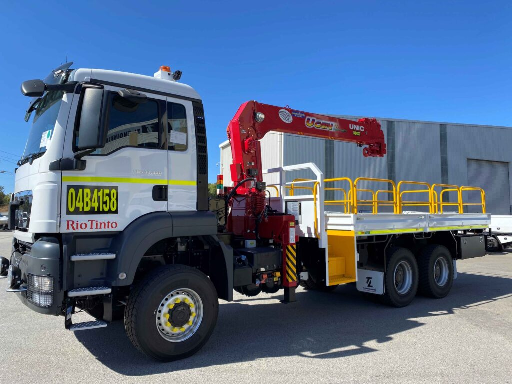 Western Australian flatbed mining truck fitted with a HIAB crane in Western Australia.